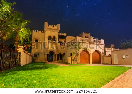 DUBAI, UAE - MARCH 31, 2014: Architecture of Palm Jumeirah island in Dubai at night, United Arab Emirates. The Palm Jumeirah is an artificial archipelago created by the Dubai government in UAE. - stock photo