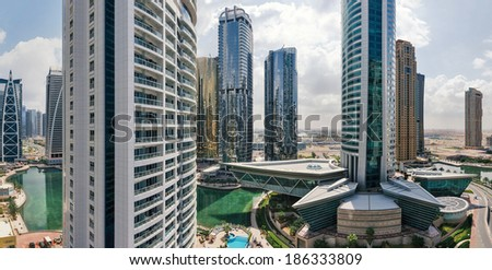 DUBAI, UAE - MARCH 27, 2014: Buildings of Jumeirah Lakes Towers. The JLT is a large development which consists of 79 towers being constructed along the edges of 4 artificial lakes.  - stock photo