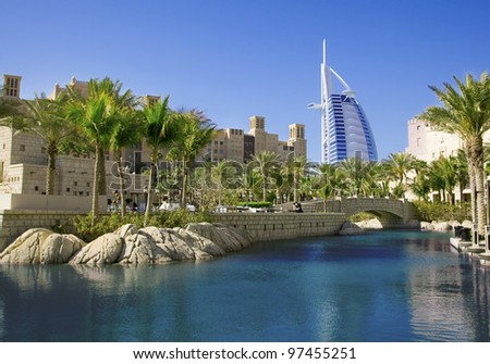 DUBAI, UAE -  MARCH 08: Burj Al Arab hotel on March 08, 2012 in Dubai. Burj Al Arab is the fourth tallest hotel in the world. Architect Tom Wright. View from Madinat Jumeirah, largest resort in Dubai - stock photo