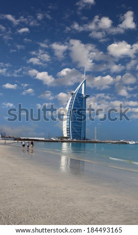 DUBAI, UAE - MARCH 07, 2014: Burj Al Arab luxury hotel in Dubai  on March 07, 2014. First 7-star hotel on the world and is the fourth tallest hotel in the world. - stock photo