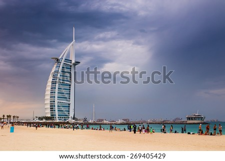 DUBAI, UAE - MARCH 27 2015 : Burj Al Arab, One of the most famous landmark of United Arab Emirates. Picture taken during cloudy weather on March 27, 2015. - stock photo