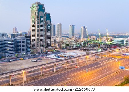 DUBAI, UAE - MARCH 30: Cars on Sheikh Zayed Road in Dubai on March 30, 2014, UAE. This is the longest highway in the United Arab Emirates and links the two largest cities - Abu Dhabi and Dubai. - stock photo