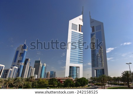 DUBAI, UAE - MARCH 8 - Emirates Twin Towers, Dubai, designed by NORR Group Consultants International. One tower is 1165 feet high and the other is 1014 feet high. Picture taken on March 8. 2014. - stock photo