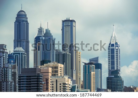 DUBAI, UAE - MARCH 27, 2014: Jumeirah Lakes Towers buildings. The JLT is a large development which consists of 79 towers being constructed along the edges of 4 artificial lakes.