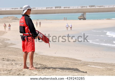 DUBAI,UAE - MARCH 12,2012: Male lifeguard at the beach hotel Jumeirah beach in Dubai. - stock photo