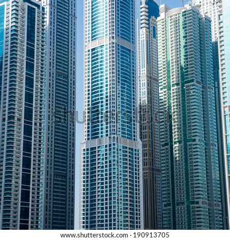 DUBAI, UAE - 7 MARCH, 2014: Modern skyscrapers in Dubai Marina, close up, in Dubai, UAE. Here is the tallest residential building in the world. March 7, 2014 Dubai, UAE. - stock photo