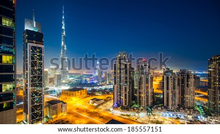 DUBAI, UAE - MARCH 28, 2014: Panoramic view of Burj Khalifa tower at night, the tallest man-made structure in the world, at 829.8 m (2,722 ft). - stock photo