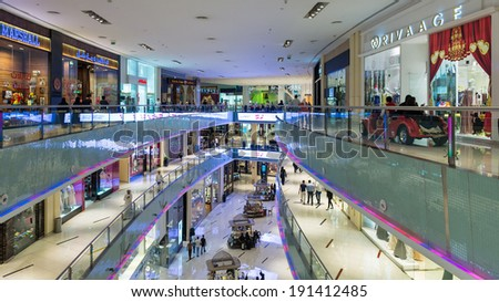 DUBAI, UAE - MARCH 28, 2014: People walking inside Dubai Mall. At over 12 million sq ft, it is the world's largest shopping mall.