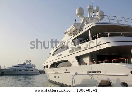 DUBAI, UAE - MARCH 06: Sapphire Trinity luxury yacht on display during Dubai International Boat Show at Dubai Marina Yacht Club on March 06, 2013 in Dubai, United Arab Emirates - stock photo