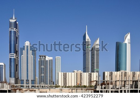 DUBAI,UAE - MARCH 10,2012:the Architecture of the houses and skyscrapers on the main street of the city of Dubai-Zayed road