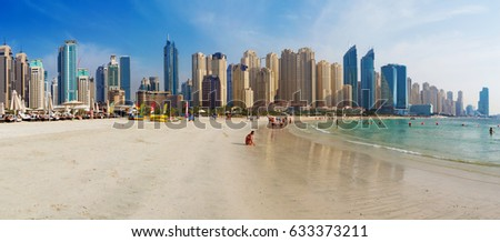 DUBAI, UAE - MARCH 28, 2017: The Marina towers from beach.