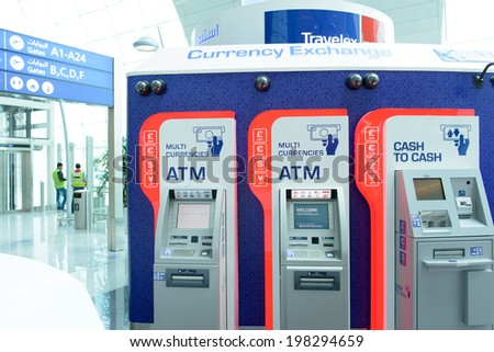 DUBAI, UAE - MARCH 31: travelex atm in airport on March 31, 2014 in Dubai. Travelex Group is a foreign exchange company founded by Lloyd Dorfman and headquartered in London. - stock photo