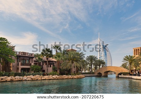 DUBAI, UAE - MARCH 29, 2014: View of the Souk Madinat Jumeirah. Madinat Jumeirah encompasses two hotels and clusters of 29 traditional Arabic houses.  - stock photo