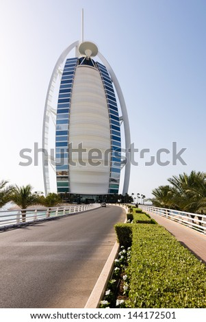 DUBAI, UAE - MAY 03: Burj Al Arab hotel on May 03, 2013 in Dubai. Burj Al Arab is a luxury 5 stars hotel built on an artificial island in front of Jumeirah beach. - stock photo