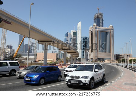 DUBAI, UAE - MAY 27: Cars on Sheikh Zayed Road in Dubai.  May 27, 2011 in Dubai, United Arab Emirates   - stock photo
