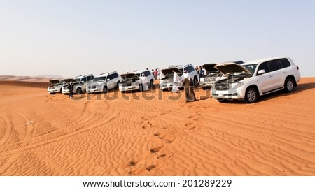 DUBAI, UAE - MAY 22: Driving a 4-wheel drive SUV on the desert, traditional entertainment for tourists on May 22, 2010 in Dubai, United Arab Emirates. - stock photo