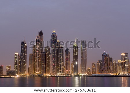 DUBAI, UAE - MAY 9: Dubai Marina skyline as seen from Palm Jumeirah on May 9, 2015 in Dubai, UAE. This part of Dubai has more skyscrapers over 50 stories that Manhattan - stock photo