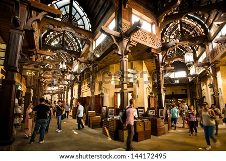 DUBAI, UAE - MAY 03: The Madinat Souk at Madinat Jumeirah Hotel on May 03, 2013 in Dubai. The traditional Arabian souk is a shopping paradise located in one of the Jumeirah Group's flagship resorts. - stock photo