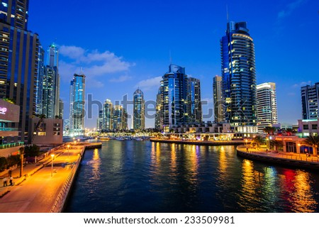 DUBAI, UAE - NOV 21, 2014 : View of modern skyscrapers in Jumeirah beach residence on November 21, 2014 in Dubai, JBR - artificial canal city, carved along a 3 km stretch of Persian Gulf shoreline. - stock photo