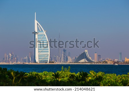 "DUBAI, UAE- NOVEMBER 7: A general view of the world's first seven stars luxury hotel Burj Al Arab ""Tower of the Arabs"" on November 7, 2013 in Dubai. Also known as ""Arab Sail"" - stock photo"