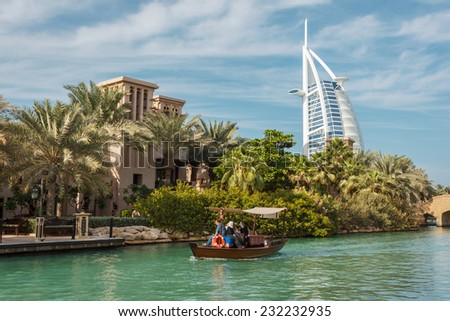 "DUBAI, UAE - NOVEMBER 15: A general view of the world's first seven stars luxury hotel Burj Al Arab ""Tower of the Arabs"", also known as ""Arab Sail"" on November 15, 2012 in Dubai, UAE - stock photo"