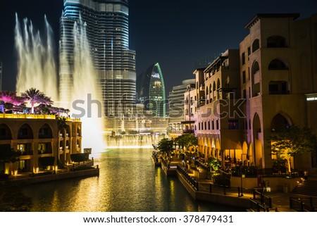 DUBAI, UAE - NOVEMBER 13: A record-setting fountain system set on Burj Khalifa Lake - 6600 lights and 25 projectors, it shoots water 150 m into the air, at November 13, 2013 in Dubai, UAE. - stock photo