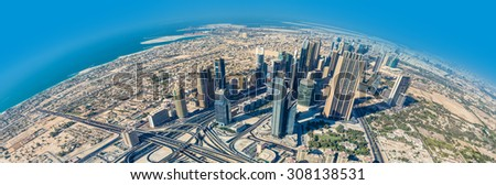 DUBAI, UAE - NOVEMBER 13: Aerial view of Downtown Dubai with man made lake and skyscrapers from the tallest building in the world, Burj Khalifa, at 828m, taken on 13 November 2012 in Dubai. - stock photo