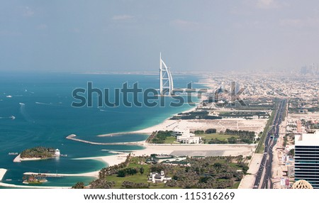 DUBAI, UAE - NOVEMBER 26: Burj Al Arab hotel on November 26, 2011 in Dubai, UAE. Burj Al Arab is a luxury 5 star hotel built on an artificial island in front of Jumeirah beach. - stock photo