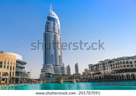 DUBAI, UAE - NOVEMBER 13: Burj Khalifa on November 13, 2012 in Dubai, UAE. Burj Khalifa is currently the tallest building in the world, at 829.84 m (2,723 ft). - stock photo