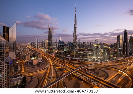 DUBAI, UAE - NOVEMBER 14: Burj Khalifa the tallest building in the world. Dubai Downtown cityscape. Dubai evening skyline, busy roads, sunset on November 14, 2015 in Dubai - stock photo