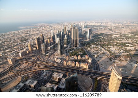 DUBAI, UAE - NOVEMBER 26: Downtown Dubai modern city. View from the lookout Burj Khalifa. United Arab Emirates, Nov 26, 2011 Dubai is the most expensive city in the Middle East. - stock photo