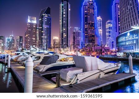 DUBAI, UAE - NOVEMBER 13: Dubai downtown night scene with city lights, luxury new high tech town in middle East. Dubai Marina cityscape,  on November 13, 2012 in Dubai, UAE. - stock photo