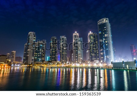 DUBAI, UAE - NOVEMBER 13: Dubai downtown night scene with city lights, luxury new high tech town in middle East, United Arab Emirates architecture on November 13, 2012 in Dubai, UAE