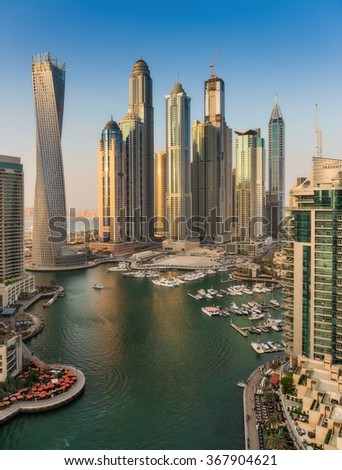DUBAI, UAE - NOVEMBER 2, 2013: Dubai Marina at Dusk from the top. In the city of artificial channel length of 3 kilometers along the Persian Gulf.