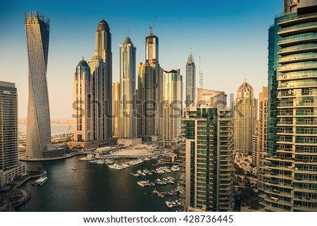 DUBAI, UAE - NOVEMBER 2: Dubai Marina at Dusk from the top, on November 2, 2013, Dubai, UAE. In the city of artificial channel length of 3 kilometers along the Persian Gulf. - stock photo