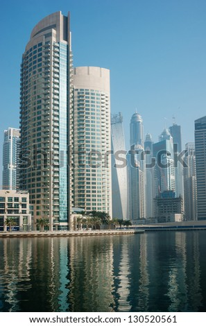 DUBAI, UAE - NOVEMBER 13: Dubai Marina at sunset, on November 13, 2012, Dubai, UAE. In the city of artificial channel length of 3 kilometers along the Persian Gulf.