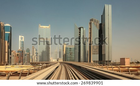 DUBAI, UAE - NOVEMBER 3: Dubai Metro as world's longest fully automated metro network (75 km) on November 3, 2013, Dubai, UAE.Toned - stock photo