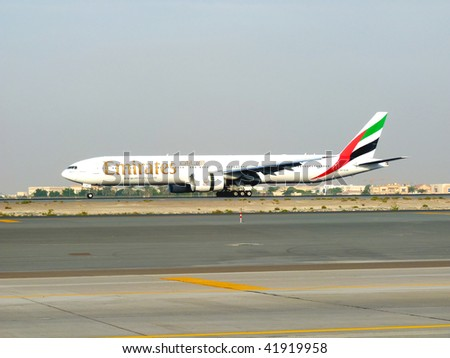 DUBAI, UAE - NOVEMBER 18: Emirates Boeing 777 aircraft landing during Dubai Air Show at Airport Expo Dubai November 18, 2009 in Dubai, United Arab Emirates. - stock photo