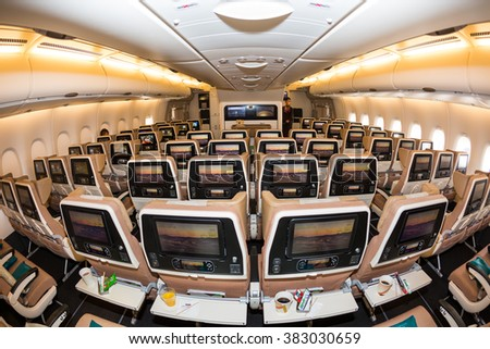 Dubai, UAE - NOVEMBER 09, 2015: Etihad Airways Airbus A380 economy class seats. Airbus A380 economy class cabin. Etihad Airways E-BOX inflight entertainment system on November 09, 2015 in Dubai - stock photo