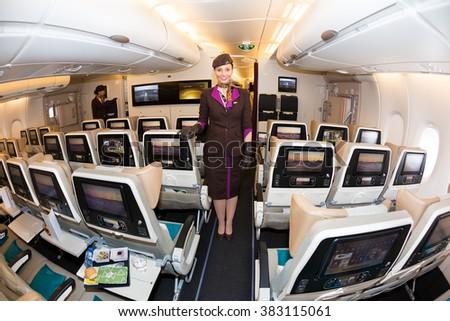 Dubai, UAE - NOVEMBER 09, 2015: Etihad Airways Airbus A380 stewardess, flight attendant. Etihad airways airplane.Economy class seats. Etihad stewardess, cabin crew member on November 09, 2015 in Dubai - stock photo