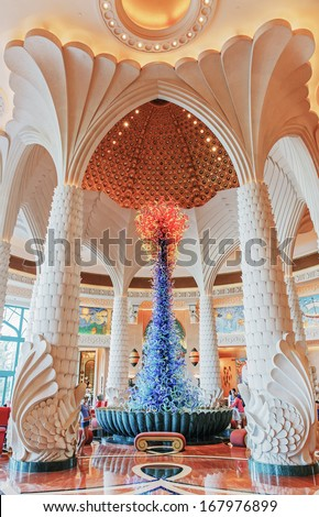 DUBAI, UAE-NOVEMBER 3: Hall of the Atlantis Hotel on November 3, 2013 in Dubai, UAE. The resort consists of two towers linked by a bridge, with a total of 1539 rooms. - stock photo