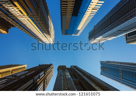 DUBAI, UAE - NOVEMBER 13: High rise buildings and streets in Dubai, UAE - stock photo