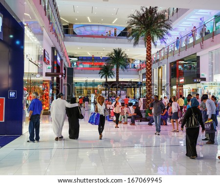 DUBAI, UAE - NOVEMBER 9: Inside modern luxury mall on November 9, 2013 in Dubai. At over 12 million sq ft, it is the world's largest shopping mall based on total area. - stock photo