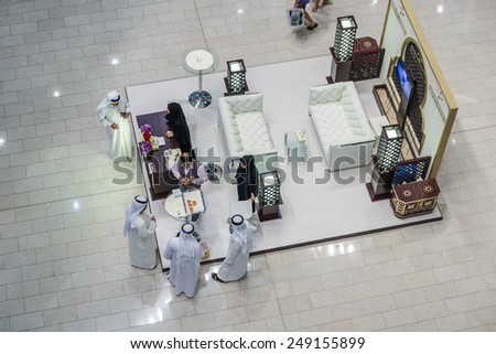 DUBAI, UAE - NOVEMBER 9, 2013: Inside modern luxuty mall . At over 12 million sq ft, it is the world's largest shopping mall based on total area. - stock photo