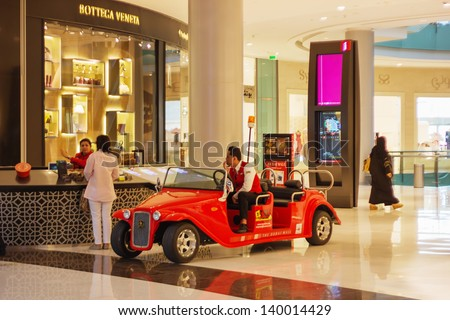 DUBAI, UAE - NOVEMBER 14: Inside modern luxuty mall on November 14, 2012 in Dubai. At over 12 million sq ft, it is the world's largest shopping mall based on total area. - stock photo