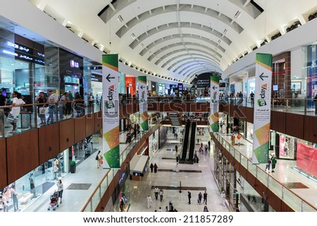 DUBAI, UAE - NOVEMBER 9: Inside modern luxuty mall on November 9, 2013 in Dubai. At over 12 million sq ft, it is the world's largest shopping mall based on total area.
