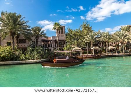 DUBAI, UAE - NOVEMBER 23: Madinat Jumeirah luxury hotel in a summer day in Dubai, UAE on 23 November 2015 - stock photo