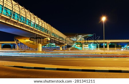 DUBAI, UAE - NOVEMBER 11, 2013: Metro subway station at night. Dubai Metro as world's longest fully automated metro network 75 km. - stock photo