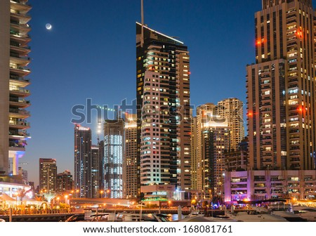 DUBAI, UAE - NOVEMBER 16: Modern buildings in Dubai Marina at night, on November 16, 2012, Dubai, UAE. In the city of artificial channel length of 3 kilometers along the Persian Gulf.