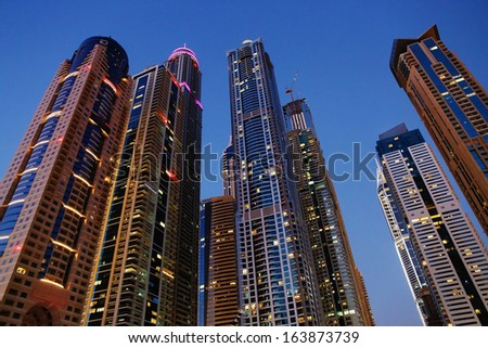 DUBAI, UAE - NOVEMBER 3: Modern buildings in Dubai Marina at night, on November 3, 2013, Dubai, UAE. In the city of artificial channel length of 3 kilometers along the Persian Gulf.